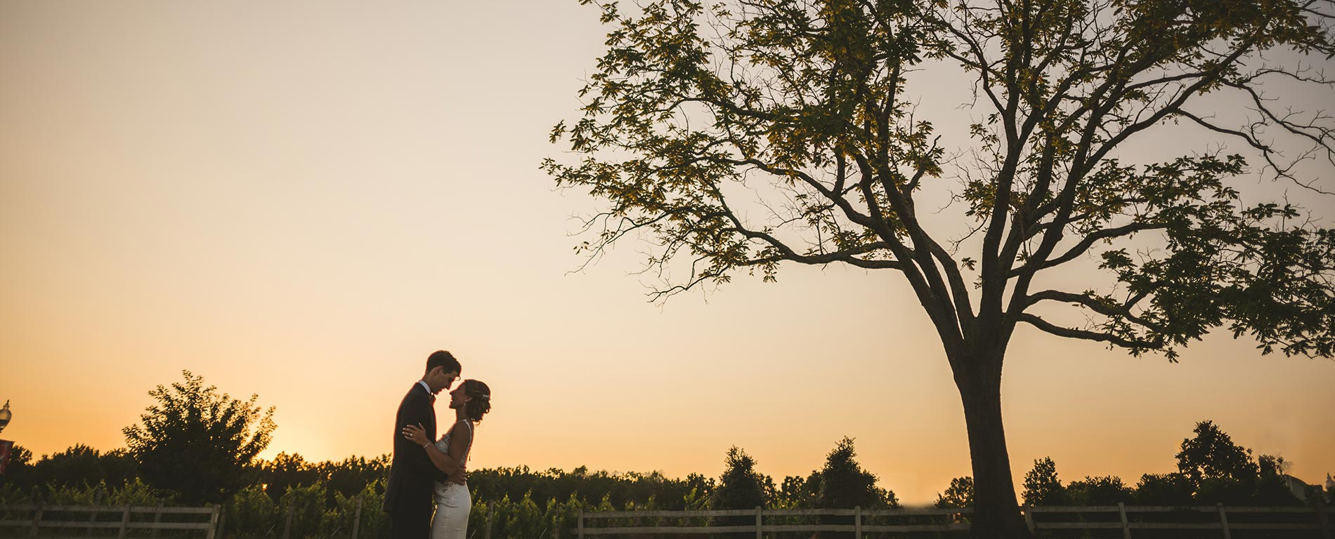 morais-vinyards-and-winery-home-slider-happy-couple-outside-sunset-vineyard Home