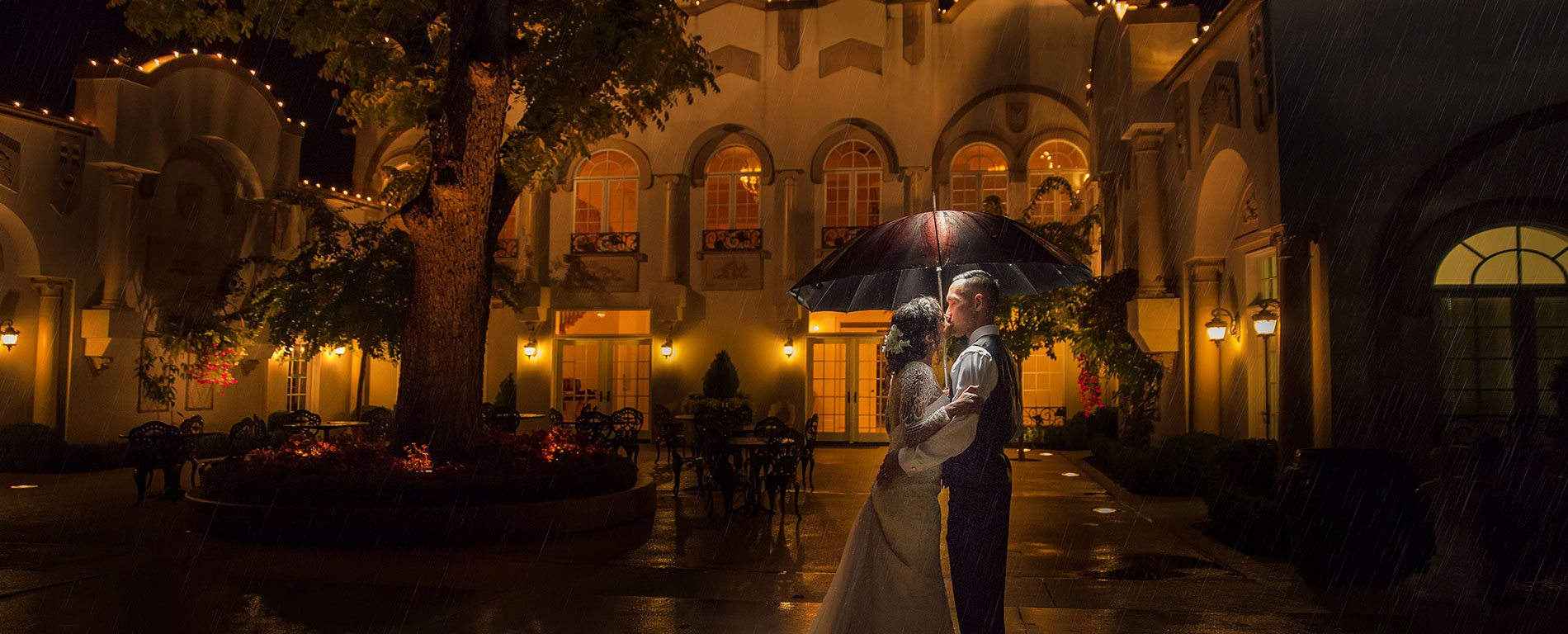 morais-vinyards-and-winery-home-slider-outside-parasol-kissing-rain Home