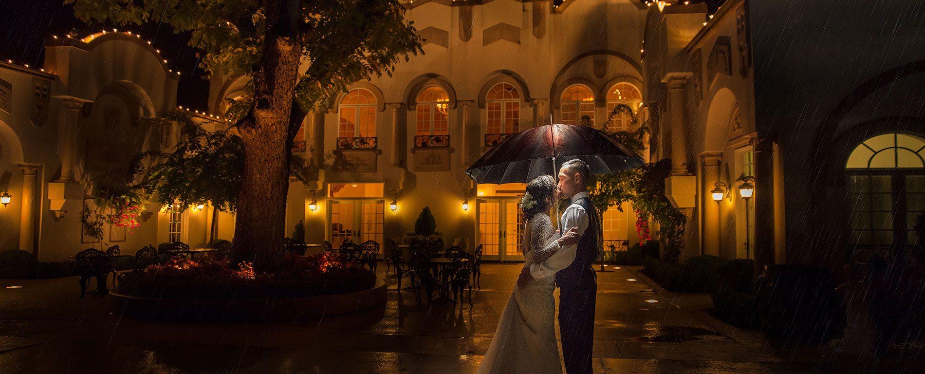 morais-vinyards-and-winery-home-slider-outside-parasol-kissing-rain Home